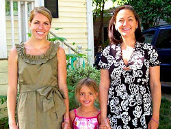 Two women with adopted daughter in the middle