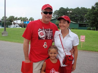 daugher and parents wearing red and white