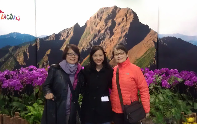 3 women in front of mountain