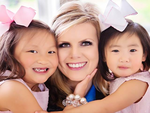 two adopted daughters with mother