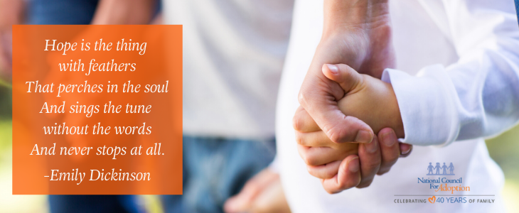 An adult hand holding a child's hand, quote